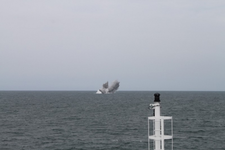 A controlled explosion initiated from a safe distance left an underwater crater 20m wide by 4m deep.